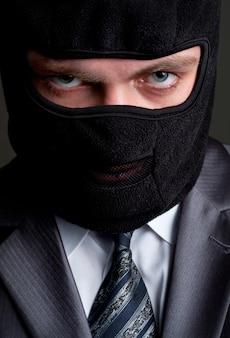 Businessman in black balaclava