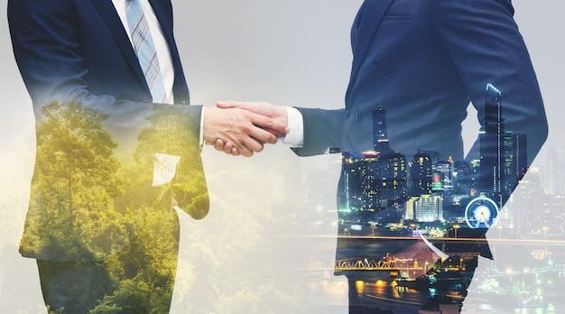 Businessman in a black suit making handshake business etiquette
