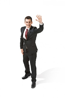 Businessman in black suit saying hello