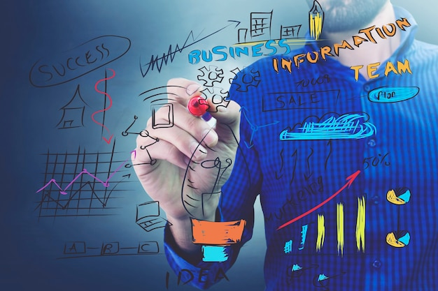 Businessman in blue shirt working with digital vurtual screen