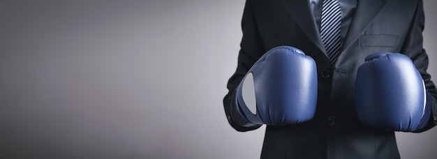 Businessman in boxing gloves. business