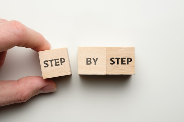 The businessman builds an abstract strategy step by step.