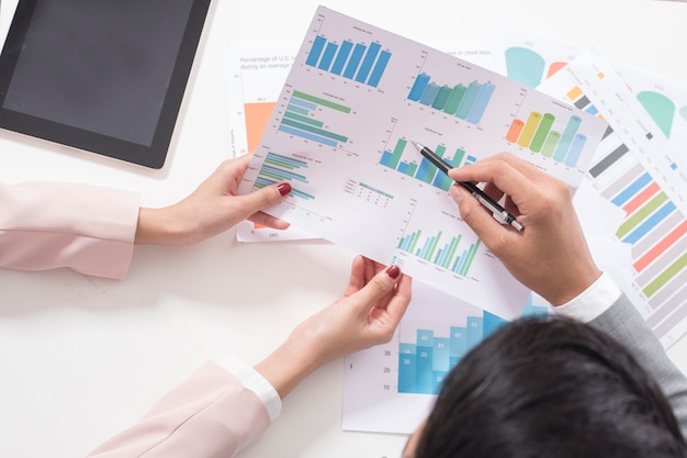 Businessman and businesswoman are analytic graph, business plan and business meeting concept