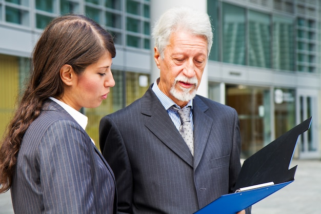 Businessman and businesswoman discussing a project