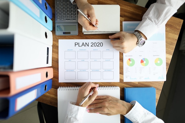 Businessman and businesswoman make work plan 2020