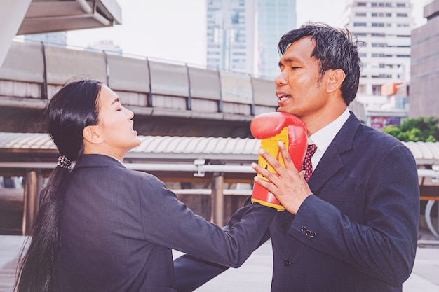 Businessman and businesswoman punching in the city