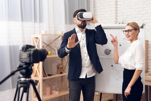 Businessman and businesswoman using vr virtual reality.