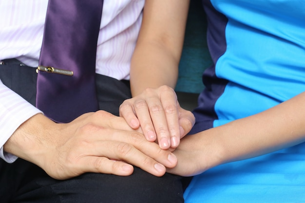 Businessman and businesswomen hold hand