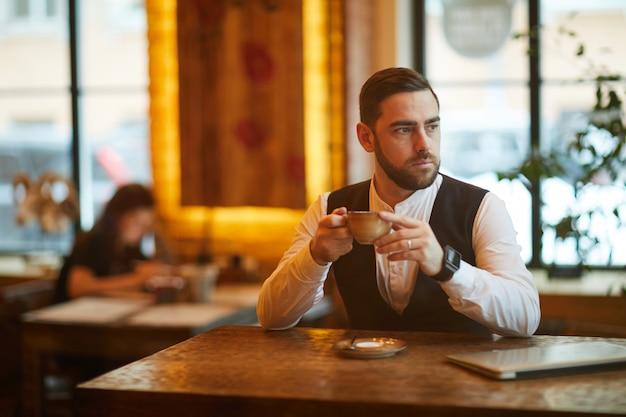 Businessman in cafe on coffee break
