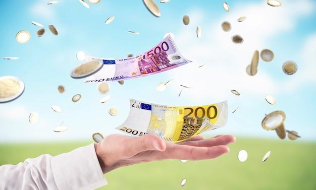 사업가 하늘에서 비가 돈을 잡는 다. 비즈니스 성공의 개념