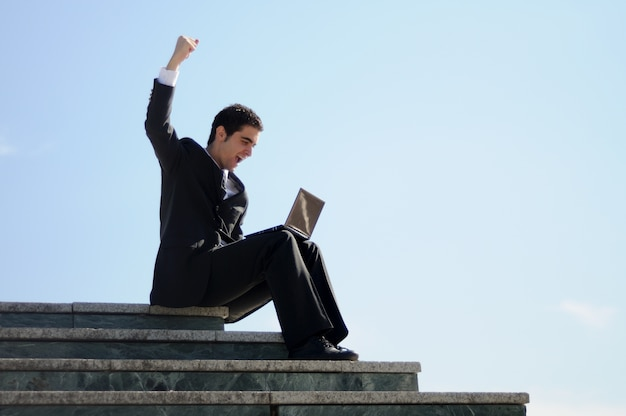 Businessman celebrating his success Free Photo