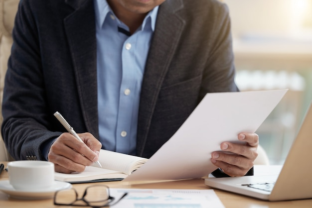 Businessman checking document