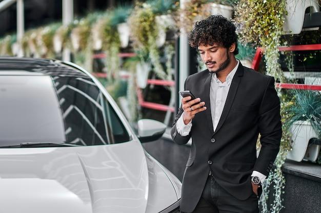 A businessman checks his email.