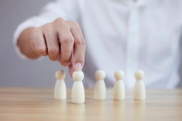 Businessman chooses best successful people model team leadership