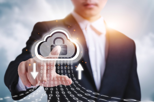 Businessman clicking cloud with security lock