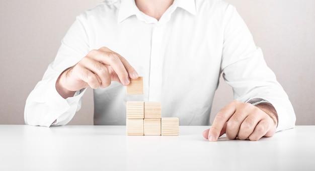 Businessman climbs the career ladder.