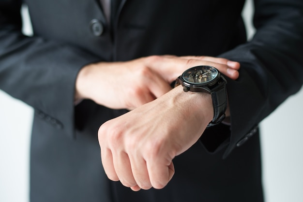 Businessman consulting wristwatch