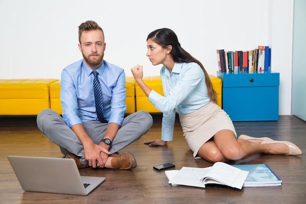 Businessman cooperation team female fist