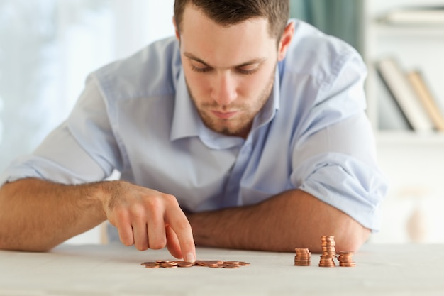 Businessman counting his small coins