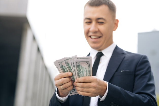 Businessman counting money usd bills payday