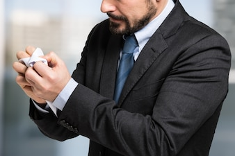 Businessman crumpling a document in his office