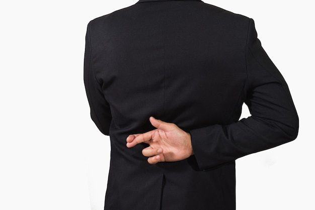 Businessman in dark suit with crossed fingers behind his back