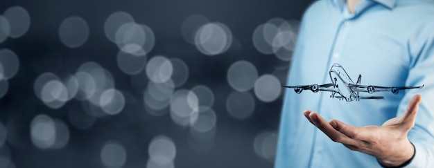 Businessman at digital background with airplane in palm