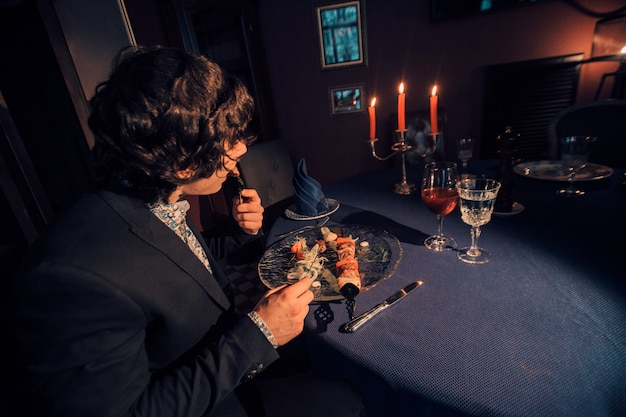 Businessman dining in a restaurant by candlelight