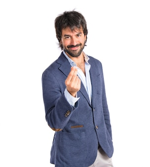Businessman doing a money gesture over white background Free Photo
