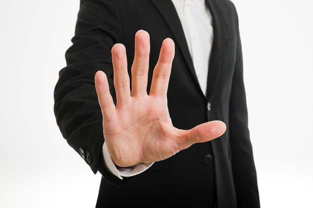 Businessman doing stop gesture