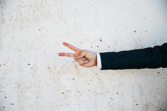Businessman doing two finger gesture