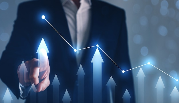 Businessman drawing on screen growing graph. business development concept.