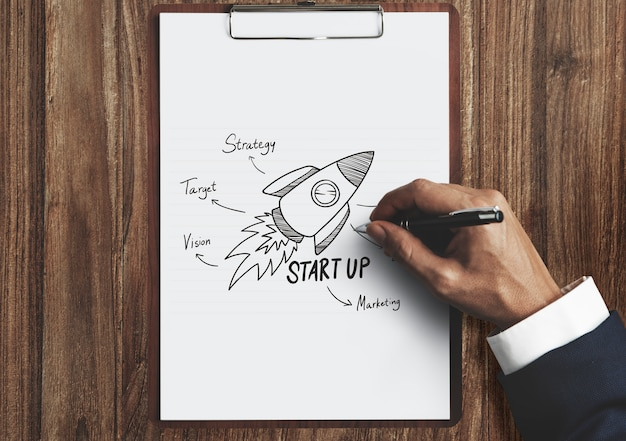 Businessman drawing a startup plan
