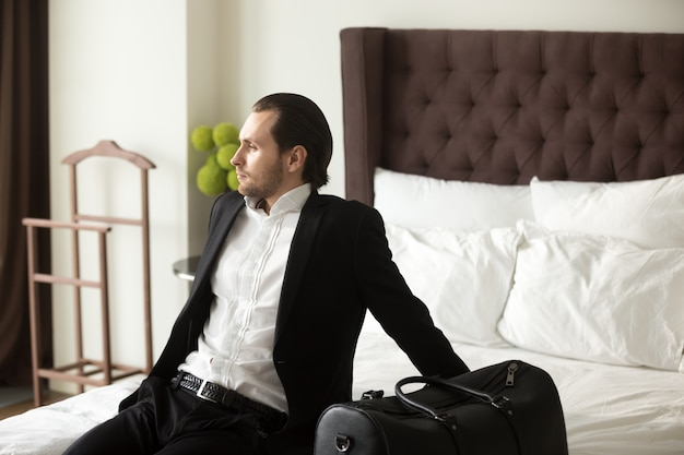 Businessman dreaming about leisure or vacation