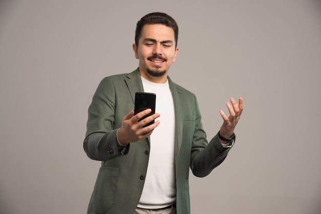 A businessman in dress code having a video call.