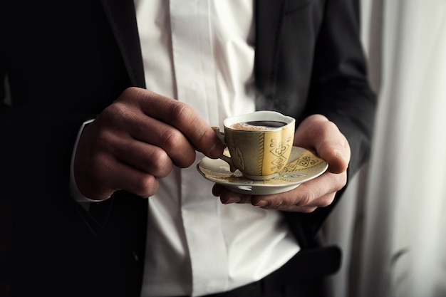 Businessman drinking coffee, morning groom, politician, man's style,male hands closeup, ,  businessman