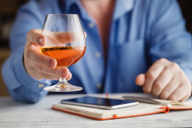 Businessman drinking cognac