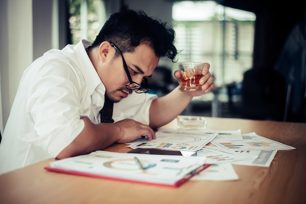 Businessman drinking at workplace
