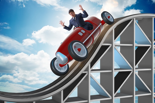 Businessman driving sports car on roller coaster