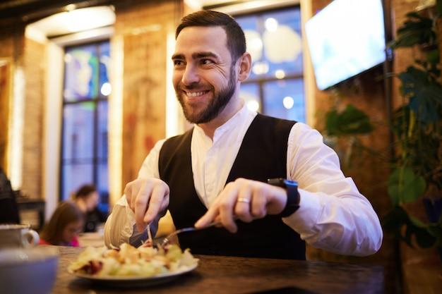 Businessman eating food n restaurant