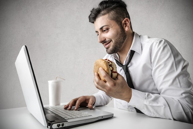Businessman eating hamburger
