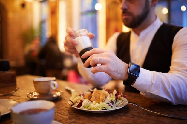 Businessman eating in restaurant