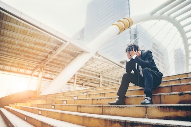 Businessman failed to feeling hopeless distraught sad and discouraged in life