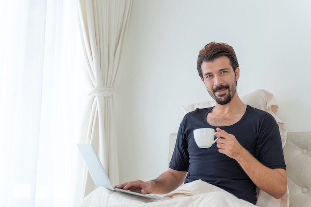Businessman feel happy drinking coffee during work at home office