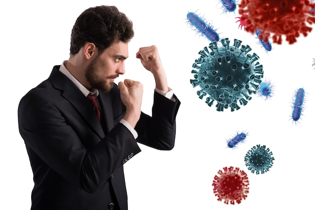 Businessman fights like a boxer. concept of viruses and bacteria attack