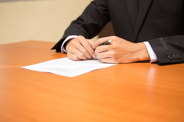 Businessman filling out the application.
