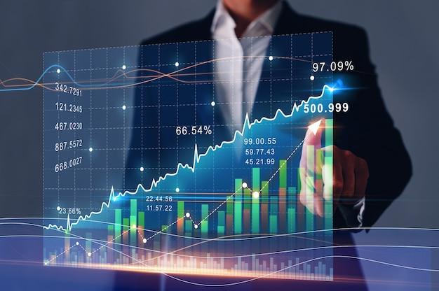 Businessman finger pointing arrow graph