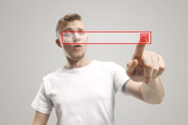 空の検索バーに触れるビジネスマンの指、現代のビジネス背景の概念-テキストや写真の挿入に使用できます。