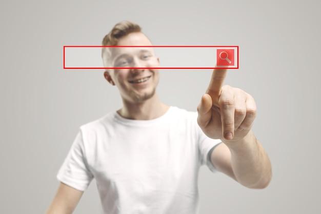 Dito dell'uomo d'affari che tocca la barra di ricerca vuota, concetto moderno del fondo di affari - può essere usato per inserire testo o immagini.