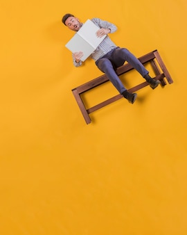 Businessman floating on a bench